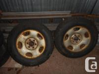 A pair of decent used studded winter tires mounted on