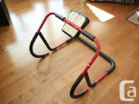 A Red, Sturdy, Ab Roller machine for sale. Still in