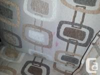 Accent Chair in natural tones, comes with cushion.