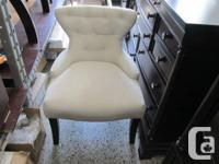 Brand new hourglass shaped accent chair available in
