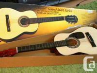 """Selling a beautiful Burswood Acoustic Guitar 30"""". Comes"""