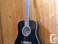 Black Acoustic Guitar, built in tuner & soft case.