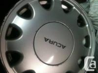 I've got a set of alloy Acura rims in good condition.