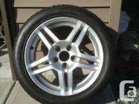 Acura tl wheels with snow tires mounted (only 2 )  70%