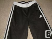 Size medium girls Adidas capri pants, black with white