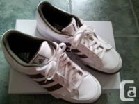 Adidas shoes that have been worn once. selling for
