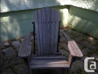 2 wood Adirondack chairs in need of repair and paint. I