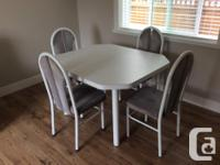 The dining table is adjustable and in great condition.