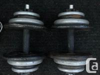 Two adjustable dumbbells. Total is 45 lbs per