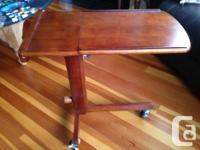Solid wood table with adjustable height. Perfect beside