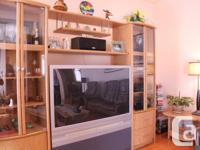 Adjustable wall-unit and tables Very good condition