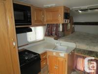 2003 Adventurer truck camper with dining table slide