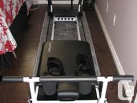 Like new, in addition to foot bar also includes pull-up