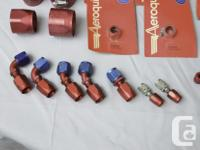 Selection of new and used Aeroquip anodized fittings