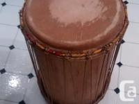 Two well kept authentic west African hand drums for
