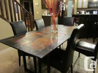 4 pieces in total all with African Slate table tops and