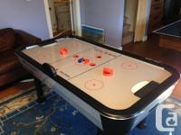 """Starcraft air hockey table. Playing surface 33' X 66""""."""