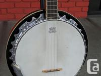 Used banjo, tuned CGDA The perfect option for someone