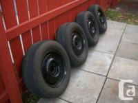 Good set of all season tires and rims off a 2001 ford