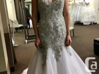 This never worn dress is for sale at Bridal Consignment