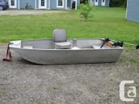 8ft aluminum boat, easy to load into back of a pickup.