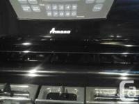 Black Amana Gas Range. Approx 5 years old. Oven will