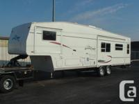 UP FOR SALE IS A 2004 AMERICAMP 32 FT 5TH WHEEL WITH 3