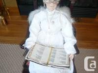 A Beautiful Figure Of a Angelic Granny Seated on a