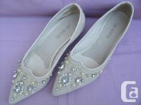 Very nice pair of low heel beige Pumps with Rhinestones