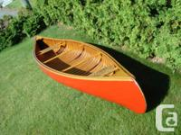 Vintage 16' Huron wood canvas canoe. First Nations