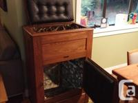 Beautifully refinished antique icebox. Lovely piece