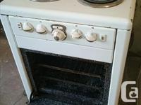Antique Beach stove as shown for sale. Good working