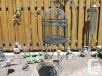 Selling an antique bird cage with beautiful arc stand.