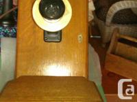 - Oak blanket box has lid that opens and drawer and