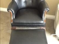 Beautiful leather chair and foot stool. Chair is