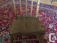This little old rocking chair has seen a lot of love,