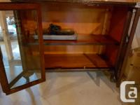 This is an antique china cabinet between 75 and 100