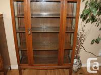 Antique china cabinet, glass on all 3 sides with 3