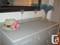 This beautiful antique Hollywood Credenza has been