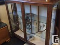 This charming antique curio cabinet is perfect for