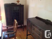 Dark brown table with six chairs, china cabinet and