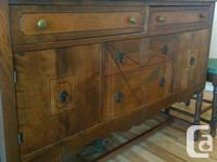 early 1900's walnut dining room suite. Table has