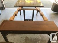 Solid Nut Brown Wood dining table. Can fold into desk