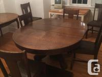 Im selling my antique dining set. it is split oak. very