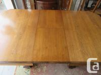 Very nice vintage walnut table with 6 chairs. Has 16""