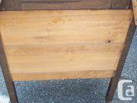 This a solid wood antique dresser with mirror, needs