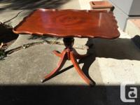 Mahogany flip-top table with piecrust edge, carved legs