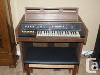 Antique electric organ in good working condition.