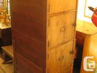 Solid wood antique file cabinet.  Doors open out