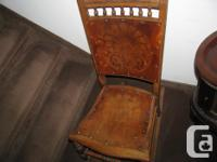 The back and seat are stenciled and are attached with